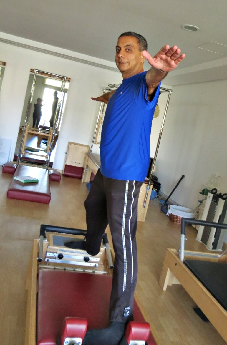 Moe Kassam at the Hundred Pilates Studio and under Jeanique's expert guidance as he trains on the reformer machine. | www.thehundred.ae